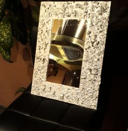 Mirror in a decor frame