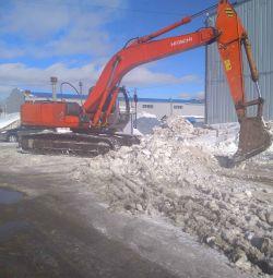 Închirierea excavatorului Caterpillar Hitachi 230lc