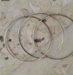 Metallic golden hoops. They have never been worn. Includes