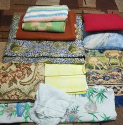 Blankets, pillows, bedding, curtains, bedspreads.