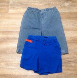 A pair of children's shorts on a boy.