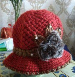 o pălărie