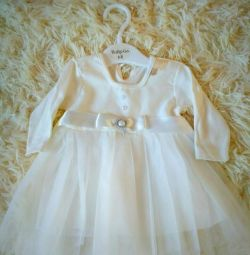 Dress is 0-3 months old.