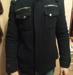 The coat is man's. Winter.