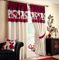 Sewing curtains on the windows