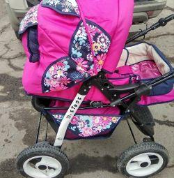 коляска рожева