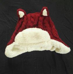 Продам теплую шапку Next