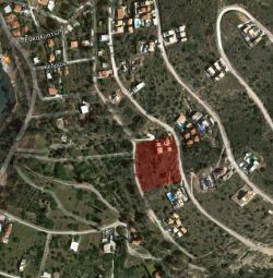 18,65% ownership of a plot of land (No 161) with a
