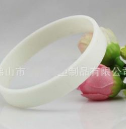 White silicone glow in the dark bracelet