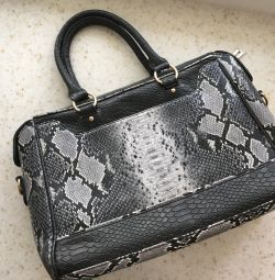Bag of arts. Leather on a snake
