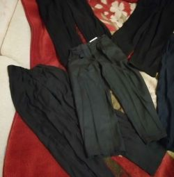 4 pairs of school trousers per boy 128-134-140cm.