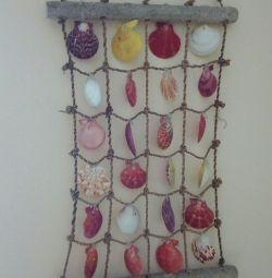 Deniz kabuklarının dekoratif paneli