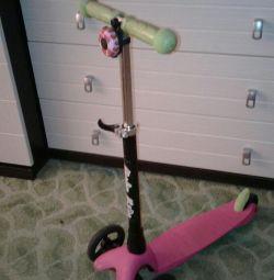 Triciclu scuter