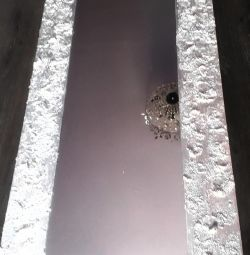 Mirror in a decorative frame