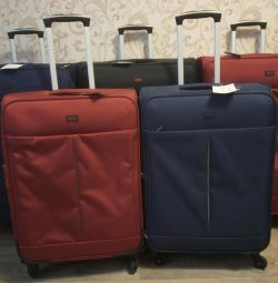 New suitcase, very large and medium, different colors