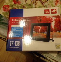New photo frame with remote control, radio, shows t *