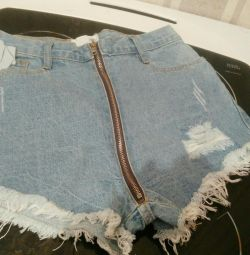 Denim shorts with zipper. Fashionable.
