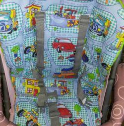 Το στρώμα στο καροτσάκι στο κάθισμα του αυτοκινήτου, το κάθισμα του αυτοκινήτου, η καρέκλα.