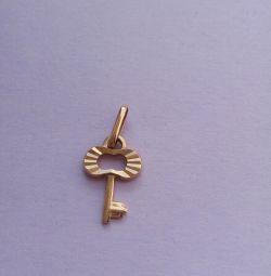 Golden key pendant