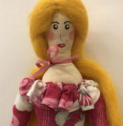 Κούκλα σε κόκκινο φόρεμα