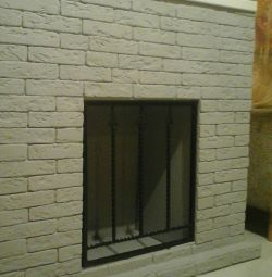False-fireplace with forged grille