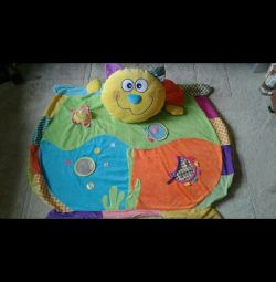 Developmental mat in the playpen.