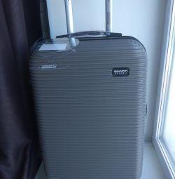 New plastic suitcase on wheels