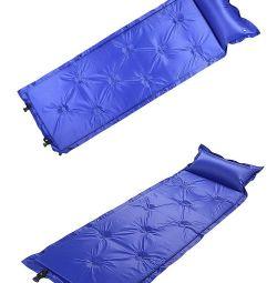 Self-inflating mat tourist mattress