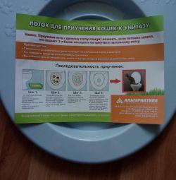 Toaletă pentru educarea pisicilor la toaletă