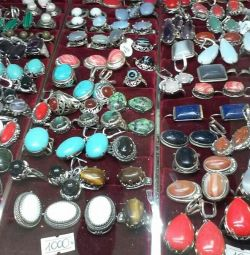 Sets of earrings and rings made of natural stones.