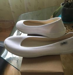 Selling white textile ballet shoes