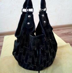 Handbag made of natural suede.