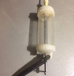 Air conditioning syringe