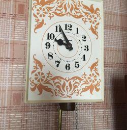 Часы с  гирей