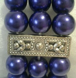 A bracelet. Purple with a pearl luster.