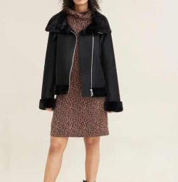 Shearling jacket with a stand-up collar