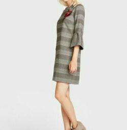 Rochie cu clopote la modă fără mâneci