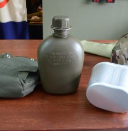 Flasks in a case with a pot.