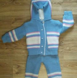 Almost new. Knitted outfit. Two-sided.