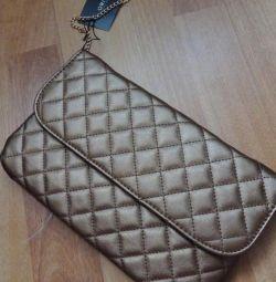 Bronze clutch bag