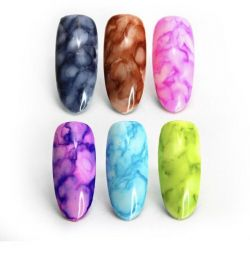 Watercolor drops for nail design.