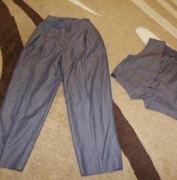 Suit. Pantolon 50 cm Sırt üstü yelek 31 cm.