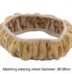 Steering wheel cover / steering wheel pad