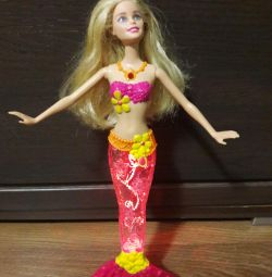 Doll mermaid with a luminous tail