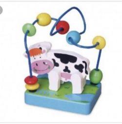 Деревянная игрушка корова