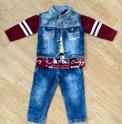 A new children's costume. Jeans, vest, T-shirt.