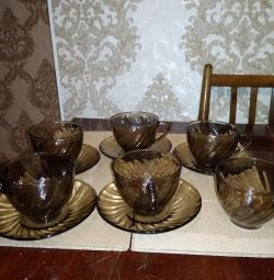 Smoked glass cups and saucers