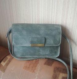 The new handbag is small
