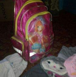 Backpack on wheels with things for a girl on the growth of 110.