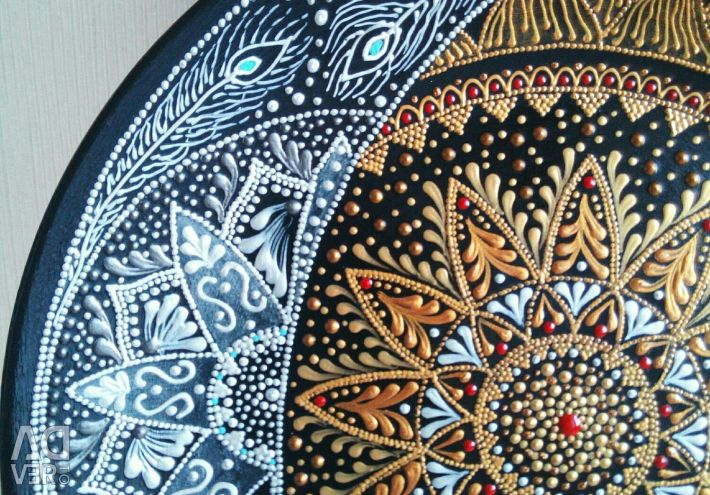 The plate is ceramic. Manual dot painting